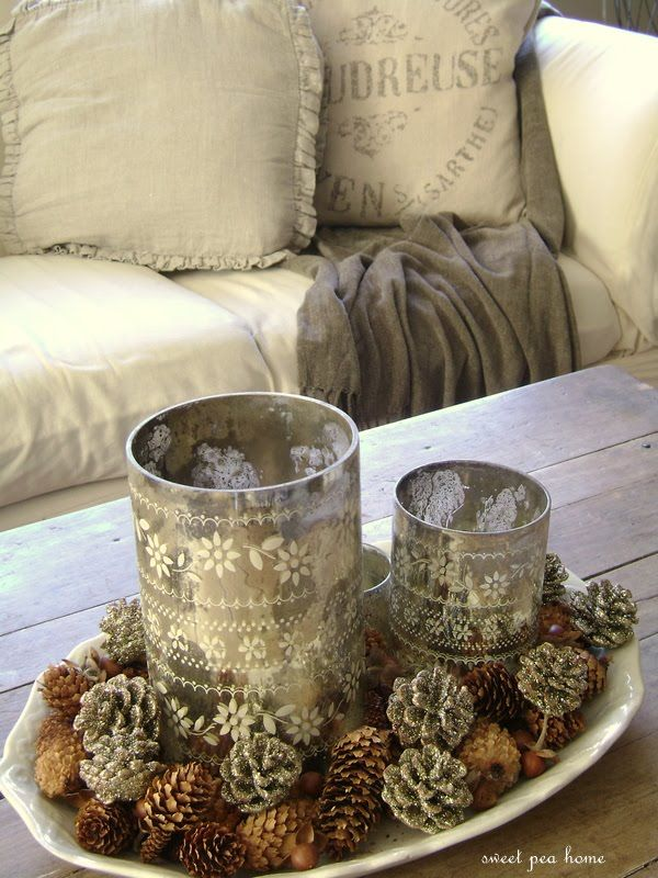 Mercury glass and pinecones love these twogether!  Can DIY project:  Instead of mercury glass use empty tin can containers and punch holes in for pattern.