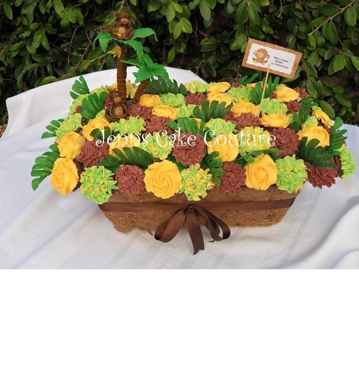 tropical cupcake bouquet with monkeys for a monkey themed baby shower.  Trees and monkeys are fondant/gumpaste mix.  Leaves are silk.  Planter box is wrapped with coconut fiber stuff you line flower pots with (I hot glued it to the pot).  This one was fun!  Oh, bouquet are mini cuppies and there are 72.   TFL