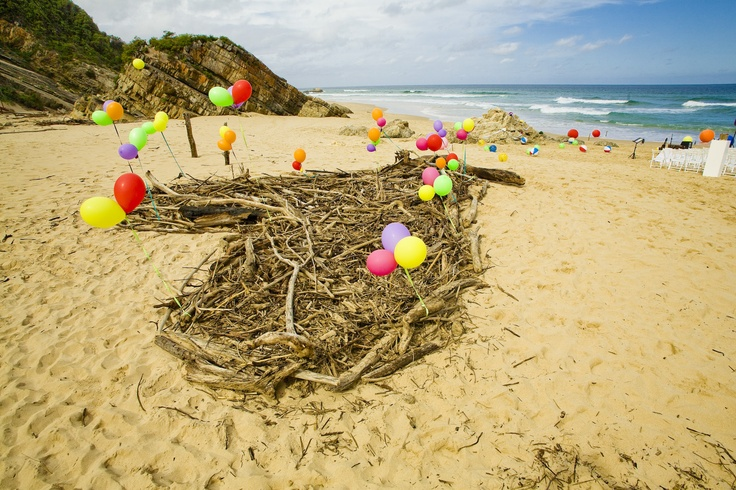 Colourful Beach Ceremony, Keurbooms, Plettenberg bay.  Guests table numbers in the balloon.