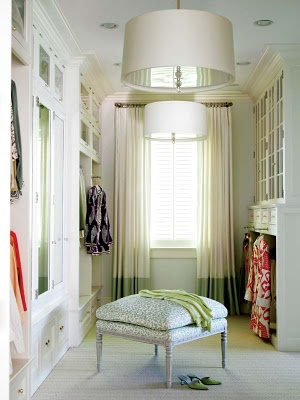 Love this walk in closet with a window in there decorated with great drapes and lighting.