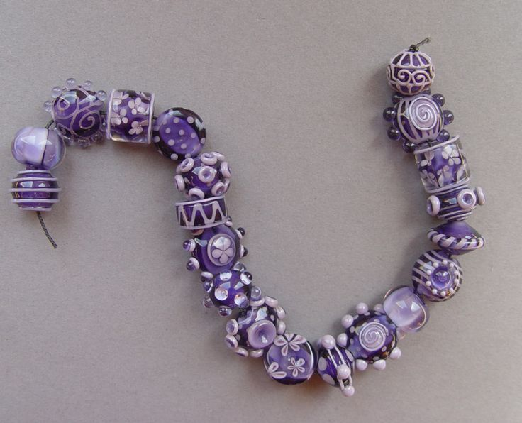 corina tettinger bead set in violet and purple love how she can create so many interesting beads with so few colours that is real talent