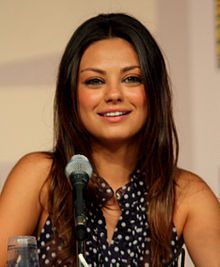 """Milena """"Mila"""" Kunis, born August 14, 1983;  is an American actress. At the age of seven, she moved from Ukraine to Los Angeles, California, with her family. After being enrolled in acting classes as an after-school activity, she was soon discovered by an agent. She appeared in several television series and commercials, before her first significant role, playing Jackie Burkhart on the television series That '70s Show."""