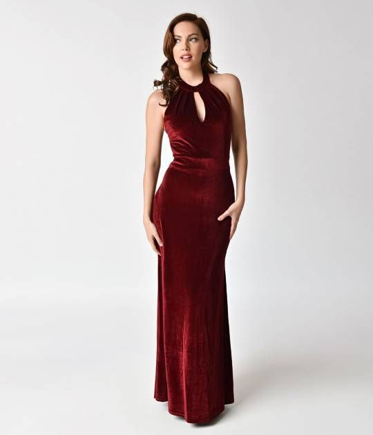 A marvelous gown for a glamorous dame! This vintage style burgundy red long dress is sweet and sultry in a soft stretch cotton velvet. The alluring sheen of this classic silhouette flatters your form with an elegant halter neckline and ravishing keyhole c