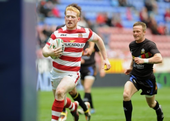 North Wales Crusaders head coach Clive Griffiths hailed Sam Tomkins as one of the greatest players in the world after the Wigan full-back ran in six tries as the Warriors kicked off their defence of the Challenge Cup with a 98-4 win over the Championship One side.