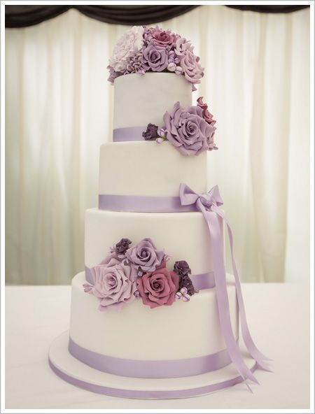 Lilac Wedding Cake maybe without the flowers on top?  Do every other tier grey?  Get more green in there with flowers?