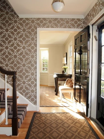 wallpaper in entry way to liven it up, even though its a small entryway putting wallpaper with this much movement in the entry, stairs, and upstairs hallway gave these spaces a huge presence