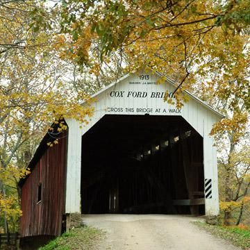 Thirty-one covered bridges punctuate Parke County's landscape like the miniature buildings in a model train set. Here, 55 miles west of Indianapolis in the Wabash River Valley. Indiana: Parke County's covered bridges. Close to home for me <3