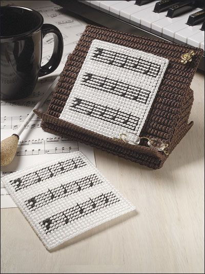 """Music lovers will love to make these coasters to set beside their piano. This e-pattern was originally published in Fun Time Coasters.Size: Coasters: 4"""" x 4 1/2"""". Holder: 4"""" x 6 1/2"""" x 6"""". Made with 7-count canvas, 6-strand floss and plastic canvas yarn.Skill Level: Easy"""