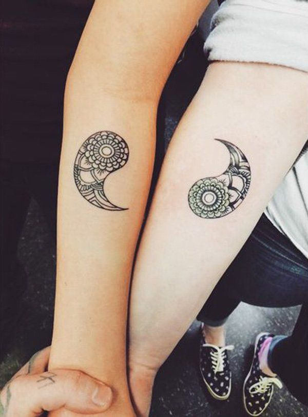 Separate Yin Yang tattoos on each arm. You can be artistic and ink the two aspects of the Yin Yang on one arm and one on the other. The intricate details on the Yin Yang elements also look amazing.