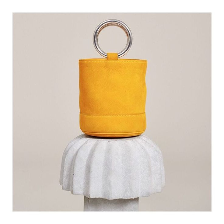 We're in love with this Simon Miller Bonsai Bag. View Details here: http://www.avenue32.com/uk/maize-suede-bonsai-bucket-bag/SIM00117010065.html?dwvar_SIM00117010065_color=159&cgid=whatsnew