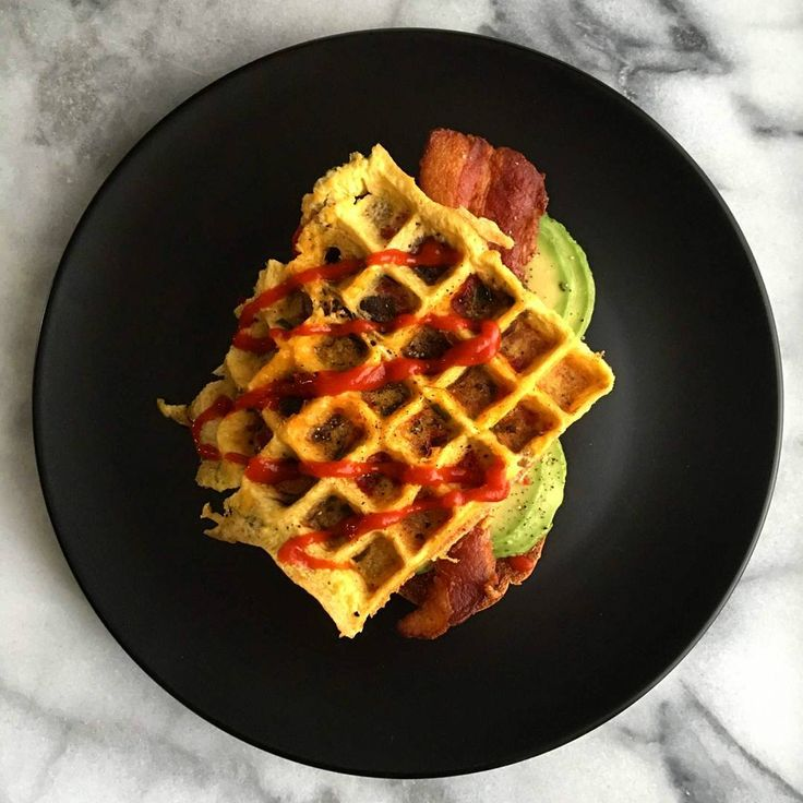 #Frittata cooked in the @allclad waffle maker, served over avocado & bacon on toast and finished with sriracha. It's hard to beat bacon and eggs to start the weekend off right. Have a wonderful day friends!@zimmysnook