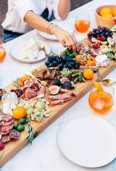 A feast for the senses - beautiful bright drag summery colours and simple white table linen and styling. The huge wooden sharif board is perfect