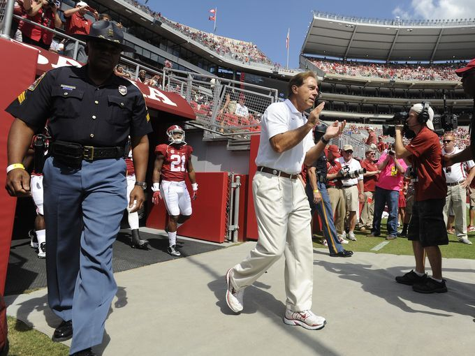 Alabama head coach Nick Saban leads his team onto the field for warmups before the Alabama Florida game at Bryant Denny Stadium in Tuscaloosa, Ala. on Saturday September 20,  2014.