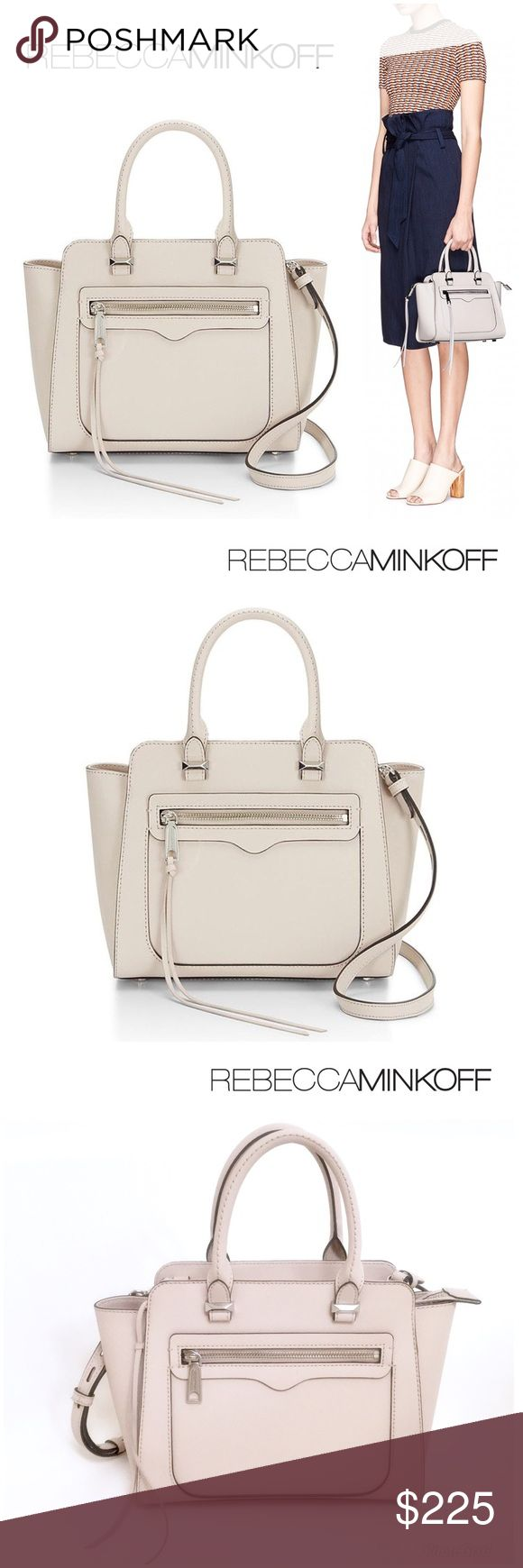 """Rebecca Minkoff Saffiano Leather Satchel Brand new with product tags, care booklet and card. Price sticker is off. Structured genuine saffiano leather brings a sophisticated finish to a mid-sized Rebecca Minkoff satchel. Details-- Genuine saffiano leather; 22"""" adjustable/ detachable shoulder strap; double rolled handles with 4"""" drop; Custom silver hardware; nameplate on back; metal feet on bottom (slight scuffs noted in picture 7); long pull on zipper; top zip closure; interior: 1 zip & 3…"""