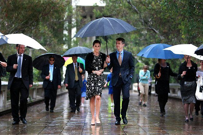 Princess Mary in Canberra Australia: Princess Mary and her husband Crown Prince Frederick of Denmark visited the National Gallery of Australia, in Canberra, Australia. Director of the NGA Ron Radford escorted the couple during the visit. The royal couple taking a walk in the rain to the National Portrait Gallery Picture: Gary Ramage
