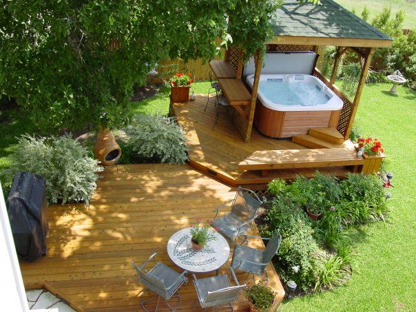 idea for porch with hottub--I like that it is set apart and on a different level.  The built-in table/bar/shelf is also nice.