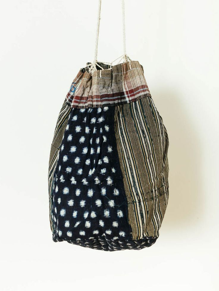 Orime Textiles: Snowball Kasuri, Stripe, And Check Komebukuro - Japanese drawstring bag made with striped and dotted fabric #bag #drawstring