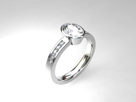Palladium engagement ring with oval cut white sapphire and diamonds by TorkkeliJewellery, $2345.00