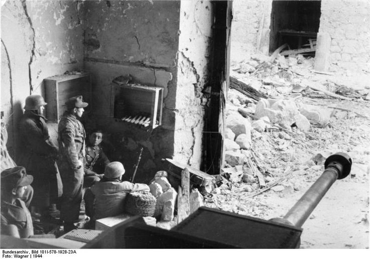 German paratroopers in the cellar of a destroyed house in Cassino, Italy, 1944, photo 3 of 3