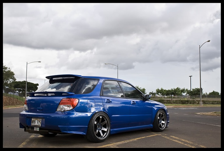 2005 WRX wagon.  I have the exact same rims and color on my car.