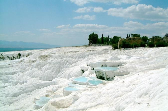 Full Day Pamukkale Hot Springs and Hierapolis Ancient City Visit miracle of the world – cotton castle of Pamukkale -whiteterraces, down of which the thermal water is flooding. Bathe in a thermal antique Cleopatra's pool and visit ancient Roman city – Hierapolis with theatre, temples and huge necropolis.After picking you up from the hotel at early morning hours we will head to the city of Denizli along the Taurus mountain chain. On our way, we will...