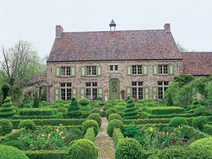 Ornamental Boxwood Parterres  Tall hedges and long walks give order and scale mature trees at Château de Courances in France.