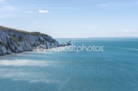 The Needles - is a row of three distinctive stacks of chalk that rise out of the sea off the western extremity of the Isle of Wight, UK, close to Alum Bay. — Foto Stock © massimilianoranauro #79824860
