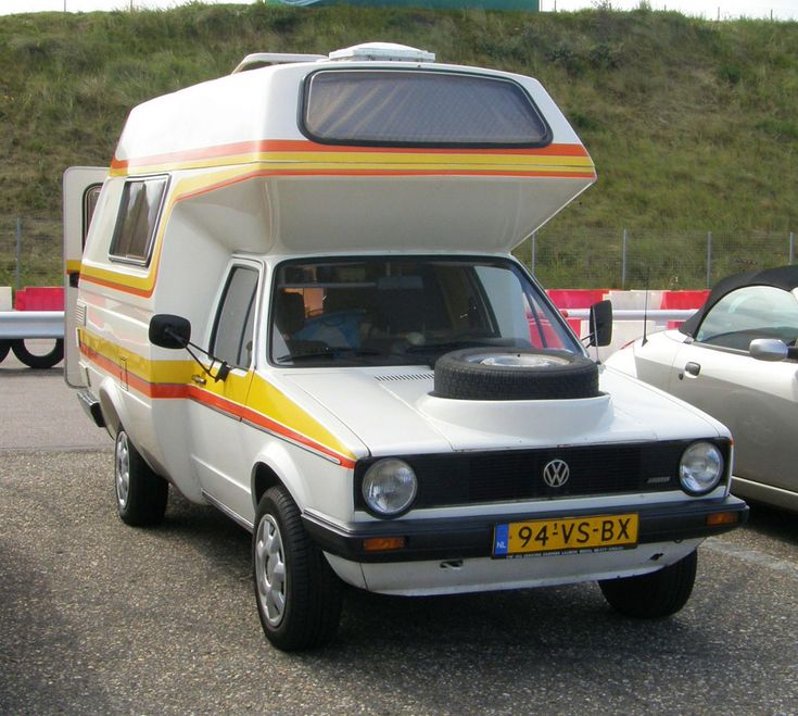 https://flic.kr/p/amD8Ni   1983 VW Caddy-Camper   Foto gemaakt tijdens het Nationaal Oldtimer Festival 2011 op het Circuit van Zandvoort, 11 september 2011.