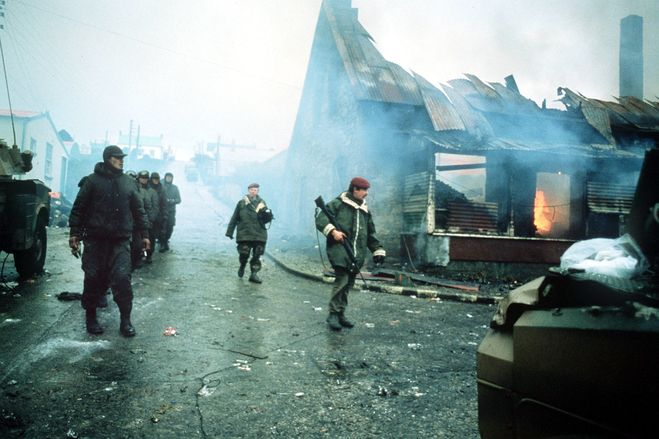 Britain went to war in 1982 after Argentina invaded the Falkland Islands. The war has been credited with helping Mrs. Thatcher win a landslide victory in the general election of 1983. Here, a line of Argentine prisoners of war were marched past a burning building in the capital, Port Stanley, in the final days of Argentine occupation of the South Atlantic islands.