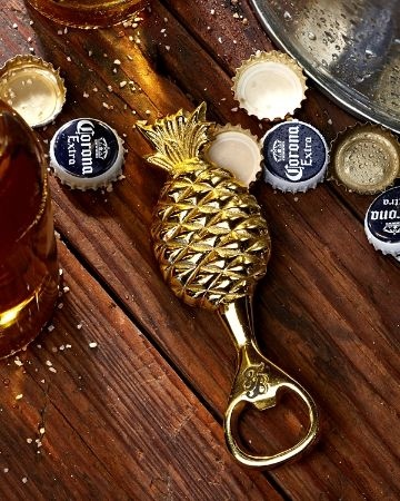 You won't want to eat this pineapple, but you will want it on hand when you're thirsty! Made from solid brass, this handy bottle opener is easy to clean and fun to use. Perfect for the kitchen, the boat or the home bar. Brass. Wipe clean with a damp cloth. 5.5in. x 2in. x 0.25in. Imported. TH33211.