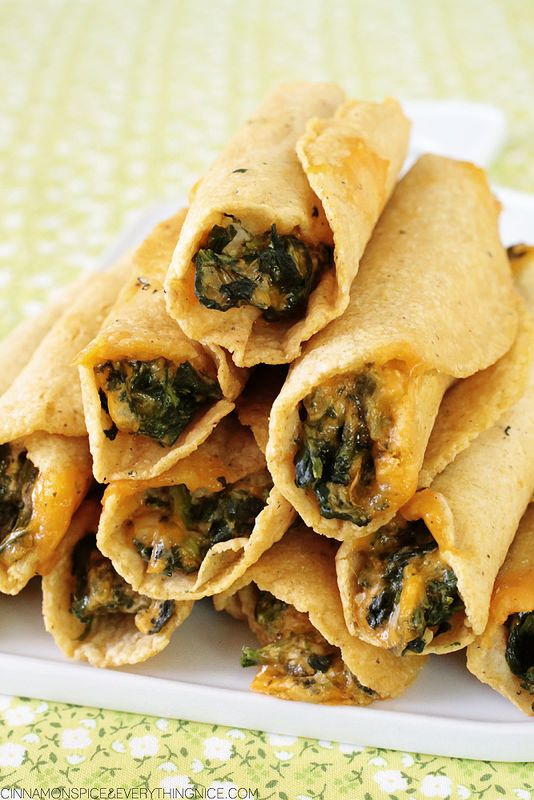 Baked Cheesy Spinach Taquitos...they're easy to make using frozen spinach, cheddar, chopped red onion and a little cream cheese, the glue to hold everything together.