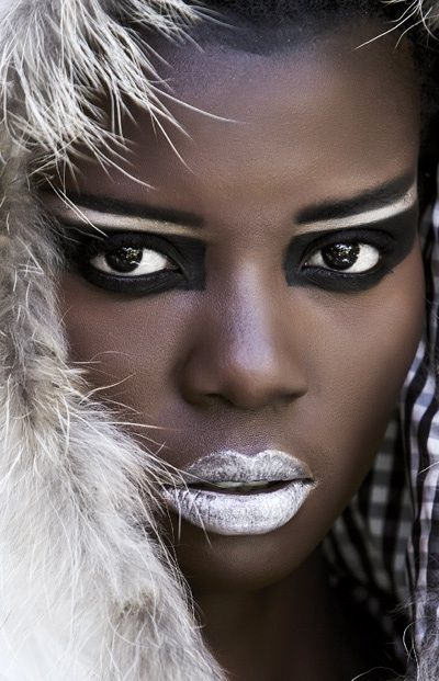 White lips and bold, tribal eyes