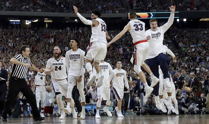 Gonzaga players celebrate after the semifinals of the Final Four NCAA college basketball tournament against South Carolina, Saturday, April 1, 2017, in Glendale, Ariz. Gonzaga won 77-73. (AP Photo/David J. Phillip) — FF208 (David J. Phillip/AP)