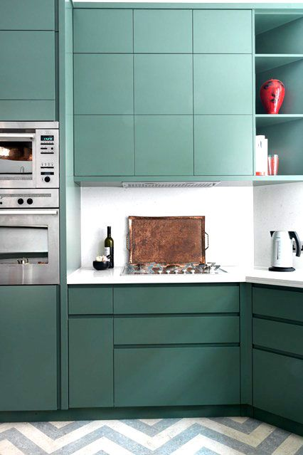 View the delightful charm of this modern green British kitchen, sprinkled with copper accents and gray and white chevron tile. Click to read COCOCOZY's blog here.