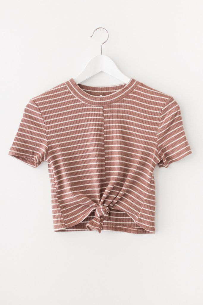 Mock neck striped crop top with front knot detail and short sleeves. Made with soft and lightweight ribbed knit material that has a good stretch. Available in rust, dusty blue or olive. 65% cotton 30% polyester 5% spandex Imported
