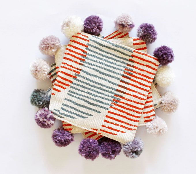 coasters with pom poms made from Skinny laMinx's DIY fabric squares