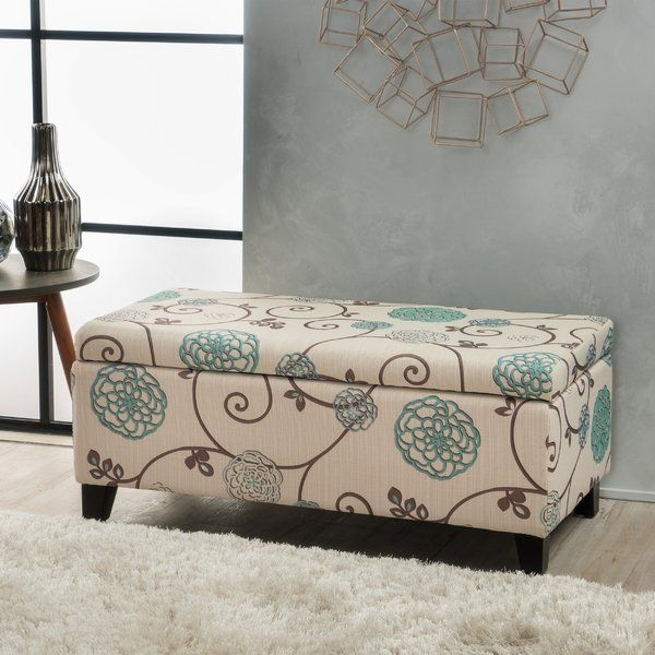 The spot where storage space meets style, this ottoman makes an ideal anchor for your living room look or an eye-catching accent at the foot of your bed. Its birch wood frame is founded atop four tapered block feet, all finished in brown for versatility. Up top, polyester blend upholstery wraps around the piece with a scrolling floral motif in hues of cream, turquoise, brown and aquamarine. Whether you're stowing blankets, shoes or anything in between, all you need to do is lift the hinge...