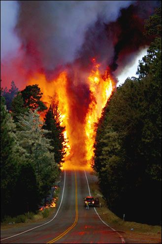The Old Fire jumping Highway 18, San Bernardino County, California of 2003 was briefly the largest in California history until the Cedar Fire overtook it.  The event became known as the 2003 Firestorm and the Fire Siege of 2003.  This was the work of an arsonist.  Troy C. Whitman