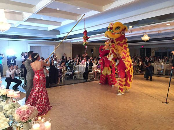 Lion dance at a Chinese Wedding. Richmond Hill Country Club Wedding.