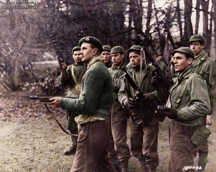 #WW2ColourisedPhotos ......... Lt John Lee Warner, British Weapon Instructor CBTC (Commando Basic Training Centre), training new US Rangers of the 29th Ranger Battalion in the use of the Thompson M1928A1 SMG. Commando Basic Training Centre, Achnacarry in the Western Highlands of Scotland. 9th of February 1943.