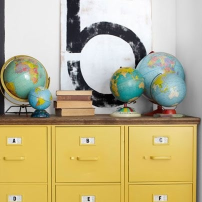 Spray paint filing cabinets and line them up then top with painted or stained plywood.