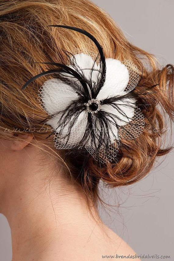 Honeycomb netting, white goose feathers, black ostrich streamers, black rhinestone center.