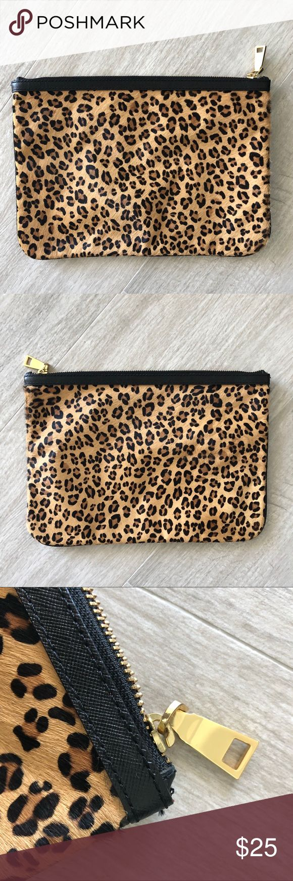 Banana Republic 🐆 clutch Banana Republic pony hair clutch in leopard print with red interior lining and gold hardware.    In very good condition. Just a little light wear to the edges. Banana Republic Bags Clutches & Wristlets