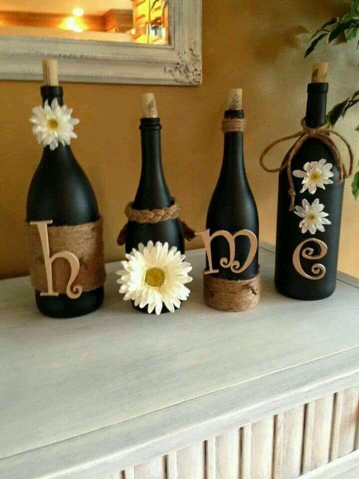 Cute craft for Recycling your old wine bottles.  Black chalkboard paint, twine, wooden letters, and decorative flowers.