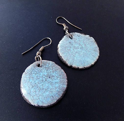 A personal favourite from my Etsy shop https://www.etsy.com/listing/560087768/raku-earrings-with-light-blue-glaze