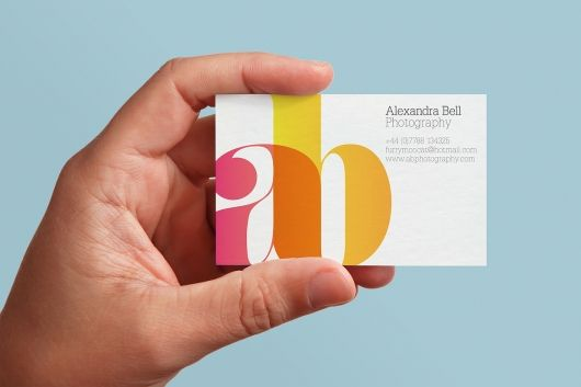 business card - beautifully designed - wish it was mine. Overlap of translucencies brings in the color photography part. Simple. Elegant.