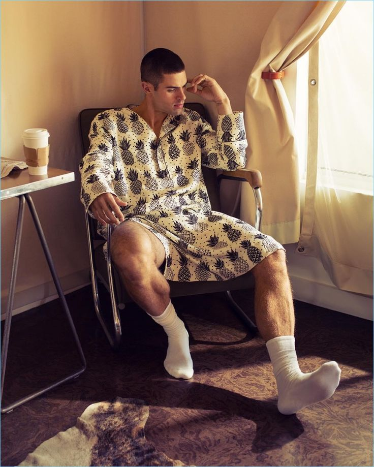 Lounging indoors, Chad White wears a Dolce & Gabbana tunic with American Apparel socks.