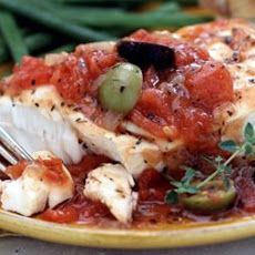 Mediterranean Fish: 4 zucchinis (medium, sliced about 1/2 inch thick), 2 tsps garlic (minced), 4 fish fillets (talapia, orange roughy), 14 1/2 oz diced tomatoes, 1 tsp fresh lemon juice, 1 tsp sugar (or 1 tsp sugar substitute), 1 tsp capers (drained and rinsed), 2 1/4 oz sliced black olives and 3/4 cup parmesan cheese (grated). (Click picture for recipe instructions)