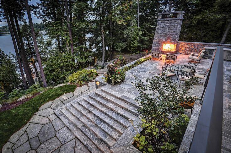 Extensive use of the Muskoka Rock Company random flagstone and square-cut flagstone at this Lake Muskoka Cottage.