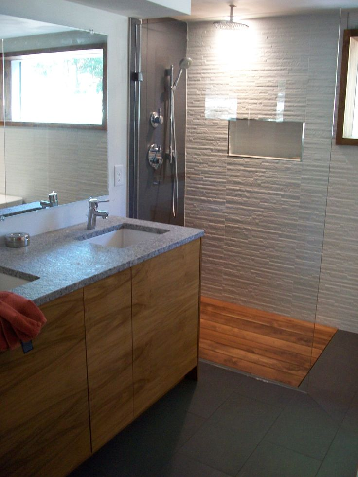 Warm up your master bath with use of natural wood products. This bath features a teak vanity and a sunken floor shower with a teak deck, modern fixtures and ...